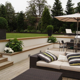 Large traditional back terrace and balcony in London.