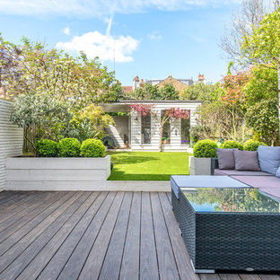 This is an example of a medium sized traditional back terrace and balcony in London with no cover.