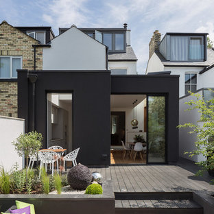 This is an example of a small contemporary back terrace in Other with no cover.