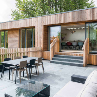 This is an example of a medium sized contemporary terrace in Cornwall with no cover.