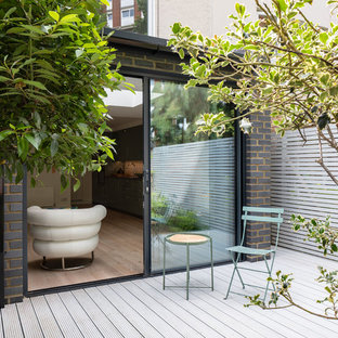 Photo of a contemporary back terrace and balcony in London with no cover.