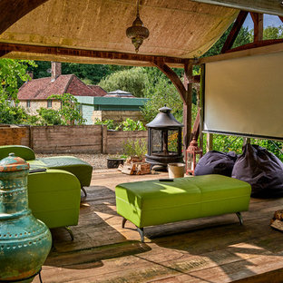 This is an example of an eclectic deck in Surrey with a roof extension.