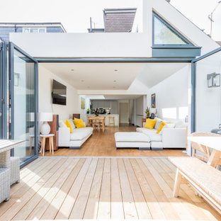 Contemporary back terrace in Sussex with no cover.