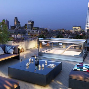 Photo of a medium sized contemporary roof rooftop terrace in London with a potted garden and no cover.