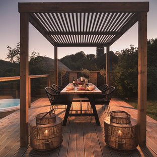 Photo of a rural side terrace and balcony in Devon with a pergola.