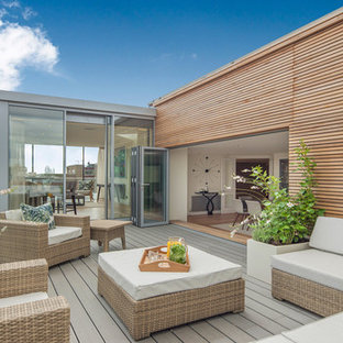 Medium sized contemporary roof terrace and balcony in London with a potted garden and no cover.