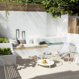 Medium sized contemporary back terrace and balcony in London with a water feature and no cover.