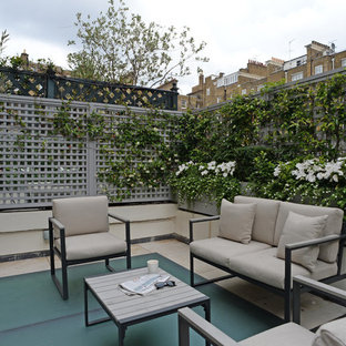 Design ideas for a small classic roof terrace and balcony in London with a potted garden and no cover.