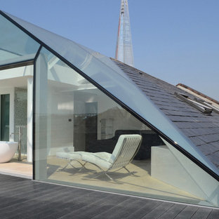 Photo of a medium sized contemporary roof terrace and balcony in London with a roof extension.