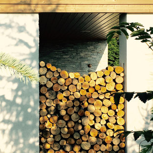 Example of a danish backyard deck design in Manchester with a fire pit