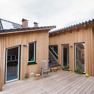 Unbedeckte, Mittelgroße Moderne Dachterrasse im Dach mit Kübelpflanzen in Hamburg