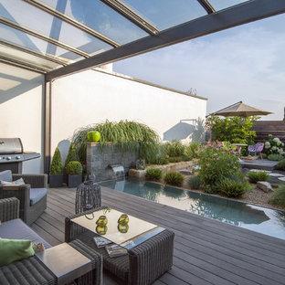 Foto de terraza actual, grande, con cocina exterior y pérgola