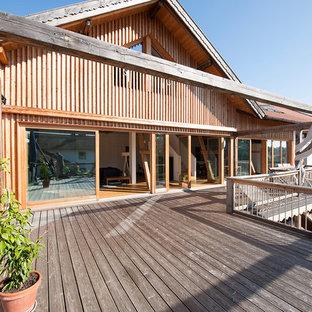 Design ideas for an expansive scandinavian terrace in Munich with an awning.