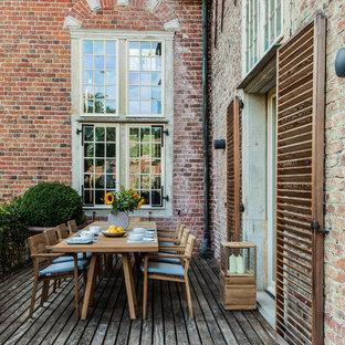 Unbedeckte, Mittelgroße Moderne Terrasse mit Kübelpflanzen in Hamburg