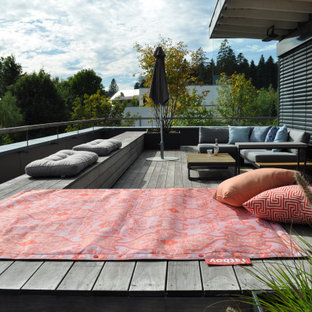 Example of a mid-sized trendy rooftop deck skirting design in Other