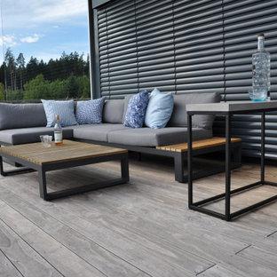Idée de décoration pour un toit terrasse design de taille moyenne avec jupe de finition.