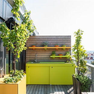 Design ideas for a contemporary roof terrace and balcony in Other with an outdoor kitchen.