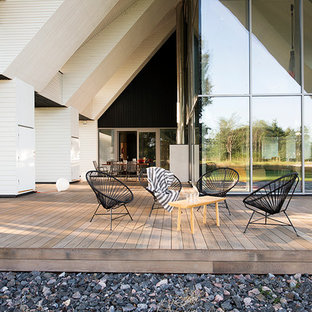 Inspiration for a huge scandinavian deck remodel in Other with a roof extension