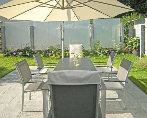 glas und edelstahl als sichtschutz im garten. Black Bedroom Furniture Sets. Home Design Ideas