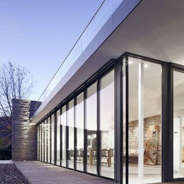 Glasfaltwände + Glas-Falttüren
