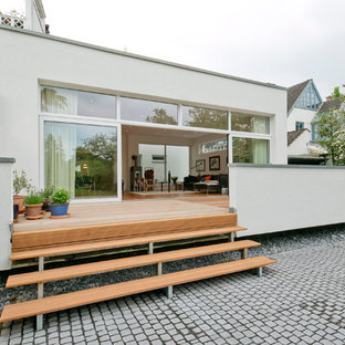 Photo of a large scandinavian terrace in Dusseldorf with a potted garden and no cover.