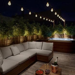 Inspiration för stora moderna takterrasser, med en vertikal trädgård
