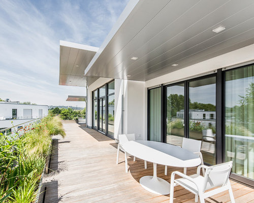 moderne terrasse mit k belpflanzen ideen design bilder houzz. Black Bedroom Furniture Sets. Home Design Ideas