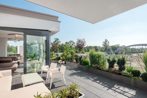 Contemporáneo Terraza y balcón by arc architekturconzept GmbH