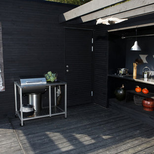 Design ideas for a medium sized scandinavian back terrace and balcony in Stockholm with an outdoor kitchen.