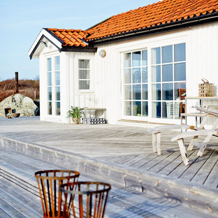 This is an example of a medium sized scandinavian terrace and balcony in Gothenburg with no cover.