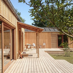 Inspiration for a large scandinavian backyard deck remodel in Aalborg