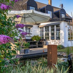 Exempel på en skandinavisk terrass på baksidan av huset