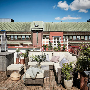 Design ideas for a large scandinavian terrace in Gothenburg with a potted garden and no cover.