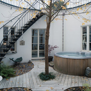 Mid-sized danish backyard water fountain deck photo in Stockholm with no cover