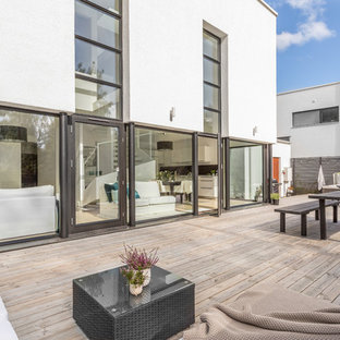 Large danish backyard deck photo in Stockholm with no cover
