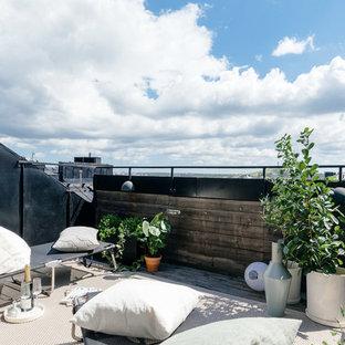 Skandinavisk inredning av en mellanstor terrass