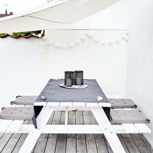 Medium sized scandinavian terrace and balcony in Other with an awning.