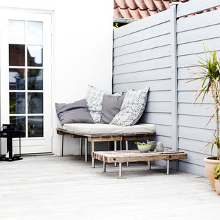 Medium sized scandinavian roof terrace and balcony in Other with no cover.