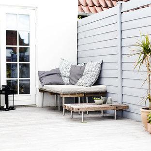 Idées déco pour un toit terrasse scandinave de taille moyenne avec aucune couverture.