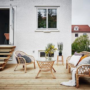 Inredning av en nordisk terrass på baksidan av huset