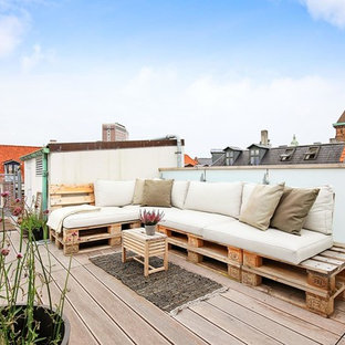 Photo of a shabby-chic style rooftop and rooftop deck in Esbjerg with a container garden and no cover.