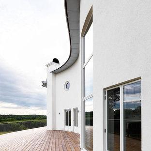 Foto på en mellanstor skandinavisk terrass på baksidan av huset
