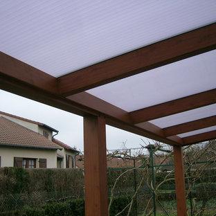 Immagine di un patio o portico country