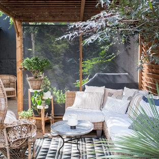 Inspiration pour une terrasse et balcon arrière bohème.