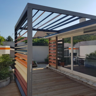 This is an example of a medium sized industrial back terrace in Montpellier with a pergola.