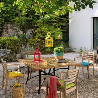 Immagine di un patio o portico country di medie dimensioni e dietro casa con nessuna copertura