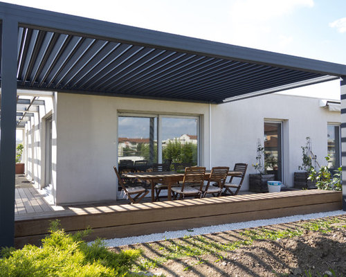 ext rieur avec une terrasse en bois moderne avec une pergola photos et id es d co d 39 ext rieurs. Black Bedroom Furniture Sets. Home Design Ideas