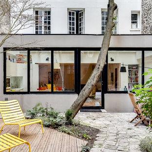 Mittelgroßer, Unbedeckter Moderner Patio mit Dielen in Paris