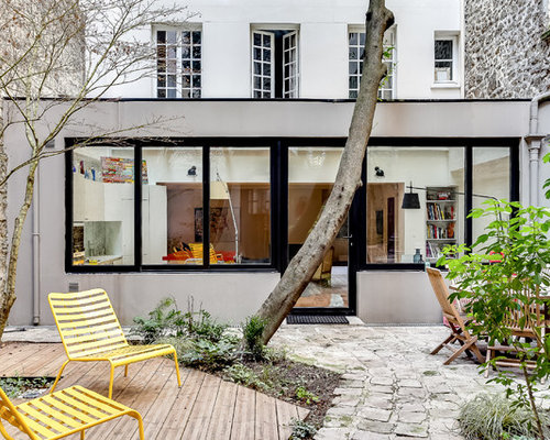 Contemporary Courtyard Covering : ... sized contemporary courtyard patio in Paris with decking and no cover