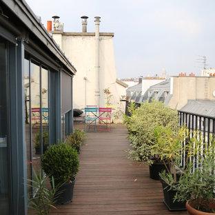 Cette image montre un toit terrasse bohème avec aucune couverture.